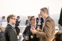 Richard Friedl mit Teilnehmern von Service Space 2014 auf der Terrasse der Wolke 19